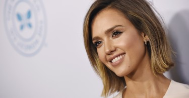 Actress Jessica Alba poses at the 30th Anniversary Impact Awards Dinner at the Beverly Wilshire Hotel, Tuesday, March 17, 2015, in Beverly Hills, Calif.