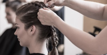 female-hairdresser-is-braiding-young-womans-hair